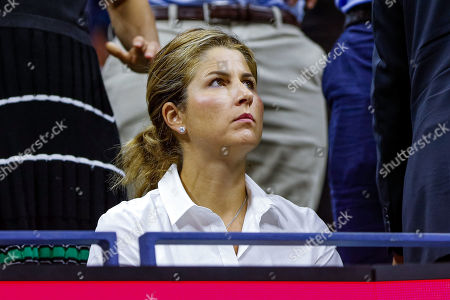 Mirka Federer shows her emotions while watching the Men's Singles quarterfinal match