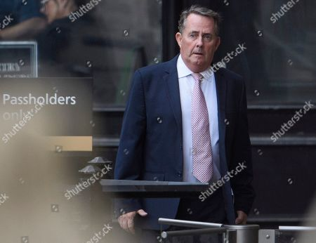 Conservative MP Liam Fox is seen at the Houses of Parliament in Westminster, London.