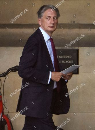 Conservative MP Philip Hammond is seen at the Houses of Parliament in Westminster, London.