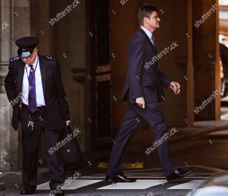 Greg Clark MP is seen at the Houses of Parliament in Westminster, London.