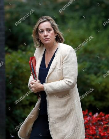 """Amber Rudd, Secreatary of State for Work and Pensions, arrives at Downing Street in London, . With Britain's prime minister weakened by a major defeat in Parliament, defiant lawmakers were moving Wednesday to bar Boris Johnson from pursuing a """"no-deal"""" departure from the European Union"""