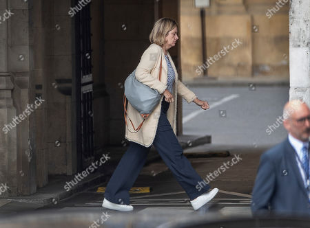 Pensions Secretary Amber Rudd walks to The House of Commons.