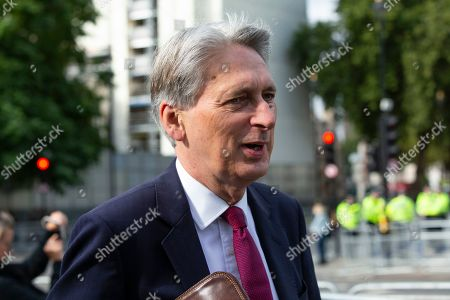 Stock Image of MP for Runnymede and Weybridge Philip Hammond arrives at Parliament ahead of Boris Johnson's first PMQs.