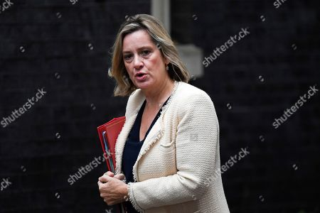 """Work and Pensions Secretary Amber Rudd arrives at Downing Street in London,. With prime minister weakened by a major defeat in Parliament, defiant lawmakers were moving Wednesday to bar Boris Johnson from pursuing a """"no-deal"""" departure from the European Union"""