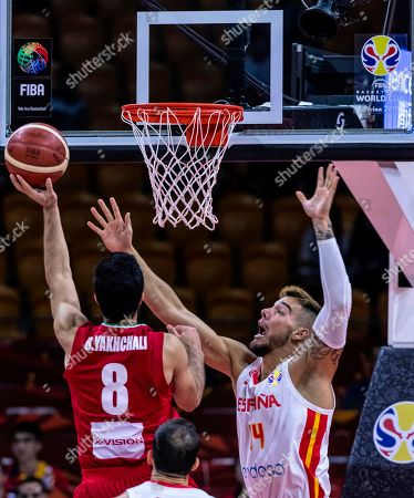 Behnam Yakhchalidehkordi of Iran (L) in action against Willy Hernangomez Geuer of Spain (R) during the FIBA Basketball World Cup 2019 match between Spain and Iran in Guangzhou, China, 04 September 2019.