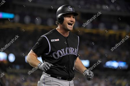 Colorado Rockies' Daniel Murphy celebrates as he scores after hitting a solo home run during the second inning of a baseball game against the Los Angeles Dodgers, in Los Angeles