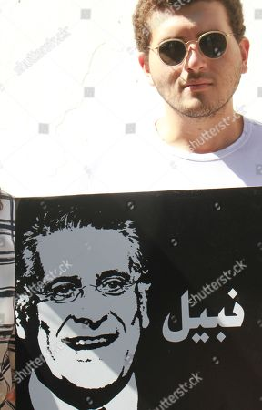 Supporters of presidential candidate Nabil Karoui carry placards with his image and slogans in his favour as they rally in front of the tribunal in Tunis asking for his release from prison on September 3, 2019. Karoui, a media magnate was arrested on August 23 for alleged money laundering but is still legally allowed to run for the September 15 presidential elections to replace late leader Beji Caid Essebsi.