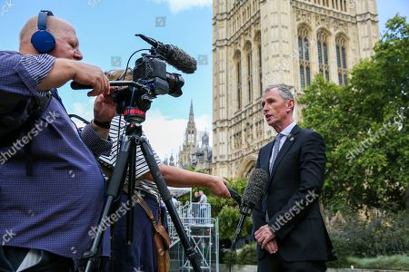 Joint Executive Secretary of the 1922 Committee Nigel Evans speaks with media in College Green.