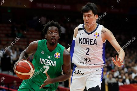 Al Farouq Aminu (L) of Nigeria in action against Choi Jun Yong of South Korea during the FIBA Basketball World Cup 2019 match between South Korea and Nigeria in Wuhan, China, 04 September 2019.