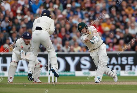 Australia's Steven Smith, bats, as England's Jos Buttler, left, and Cameron Bancroft field during day one of the fourth Ashes Test cricket match between England and Australia at Old Trafford in Manchester, England