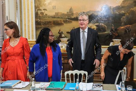 Stock Picture of Newly appointed French High Commissioner for Pension Reform Jean-Paul Delevoye center stands by French Junior Minister for European Affairs Amelie de Montchalin, left, French Government's spokesperson Sibeth Ndiaye, second left and French Overseas Minister Annick Girardin, at the start of his first cabinet meeting at the Elysee Palace in Paris, France