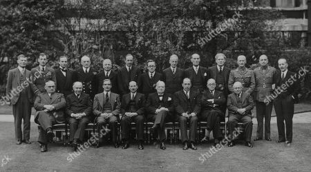 WWII: Britain: War Councils. .The War Cabinet and all the regular attenders. picture shows standing L-R: Sir Edward Bridges, Air Chief Marshal Sir Charles Portal (Chief of the Air Staff), Admiral of the Fleet Sir Dudley Pound (First Sea Lord and C.N.S.), Sir Archibald Sinclair, Mr Alexander, Lord Cranborne, Herbert Morrison, Lord Moyne, Captain David Margesson, Mr Bracken, General Sir John G. Dill (C.I.G.S. Chief of the Imperial General Staff), General Hastings Ismay, Sir Alexander Cadogan. .Seated L-R: Ernest Bevin, Lord Beaverbrook, Anthony Eden, Clement Attlee, Rt. Hon. Winston Churchill, Sir John Anderson, Mr Greenwood, and Sir Kingsley Wood