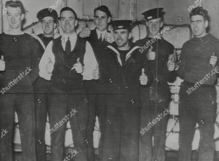 WWII: Britain: Navy: Seven Canadian sailors, survivors of the the Armed British Merchant cruiser Jervis Bay, which saved 29 known ships of her convoy and went down in Mid-Atlantic with her guns still firing at the German raider which attacked them, shown in a Naval hospital at an Eastern Canadian port, where they were taken by a Swedish freighter of the convoy, which turned back at night to look for survivors. Picture shows L-R: George Squires, of Topsail, Newfoundland, George Beaman, of Halifax, Nova Scotia, Petty Officer Dalton Greene, Ottawa, Warren Stevens, Lunenberg, Nova Scotia, John T. Smith, of Toronto, and Edward Marrow, of St. John, Newfoundland