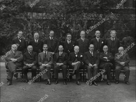WWII: Britain: War Councils.The War Cabinet and the Ministers who regularly attend. . picture shows standing L-R: Sir Archibald Sinclair, Mr Alexander, Lord Cranborne, Mr Herbert Morrison, Lord Moyne, Captain David Margesson, Mr Brendan Bracken. Seated L-R: Lord Beaverbrook, Mr Anthony Eden, Mr Clement Attlee, Rt. Hon. Winston Churchill, Sir John Anderson, Mr Arthur Greenwood, Sir Kingsley Wood