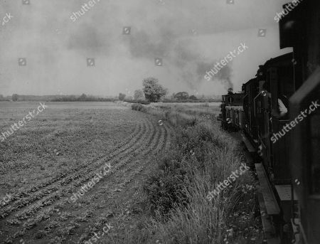 WWII: Britain: Food: Agriculture: Mr Robert Hudson, Minister of Agriculture, who through the full use of his wartime food production powers, has made the reclamation of Feltwell Fen possible. Picture shows: The 'Bread and Butter Express' passing through cultivated areas of Feltwell Fen, land that has been reclaimed