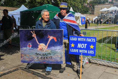 Steve Bray of SODEM poses with satirical artist Kaya Mar outside Parliament