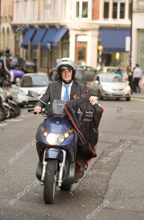 Editorial photo of Mobile taylor, Charlie Collingwood and his scooter in Savile Row, London, Britain - 29 Oct 2009