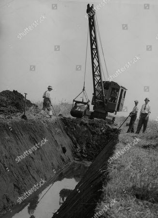 WWII: Britain: Food: Agriculture: Mr Robert Hudson, Minister of Agriculture, who through the full use of his wartime food production powers, has made the reclamation of Feltwell Fen possible. Picture shows: Cutting out dykes by drag-line