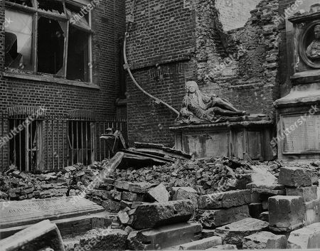 WWII: Britain: Air raids London: Picture shows: Damage surrounding the tomb of Oliver Goldsmith, celebrated biographer of Dr Samuel Johnson, in the Inner Temple, London, caused during a recent raid.