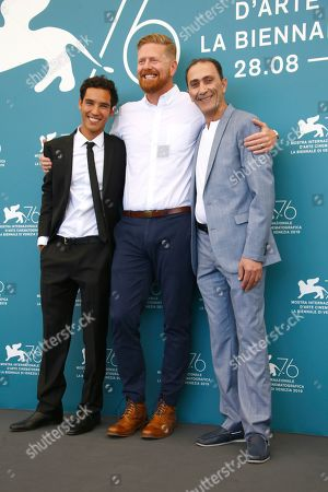 Stock Picture of Adam Bessa, from left, director Matthew Michael Carnahan and actor Suhail Dabbach pose for photographers at the photo call for the film 'Mosul' at the 76th edition of the Venice Film Festival in Venice, Italy
