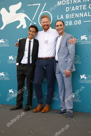 Adam Bessa, from left, director Matthew Michael Carnahan and actor Suhail Dabbach pose for photographers at the photo call for the film 'Mosul' at the 76th edition of the Venice Film Festival in Venice, Italy