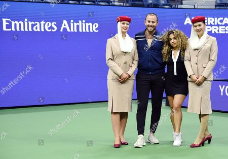 Stock Image of Micah Jesse and Tammy Christina Vahaviolos with Emirates Airline Cabin Crew members