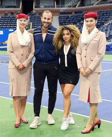 Stock Photo of Micah Jesse and Tammy Christina Vahaviolos with Emirates Airline Cabin Crew members