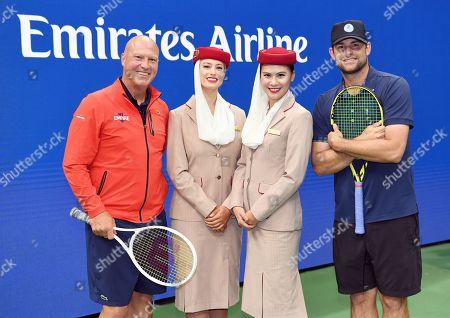 Luke Jensen and Andy Roddick with Emirates Airline Cabin Crew members