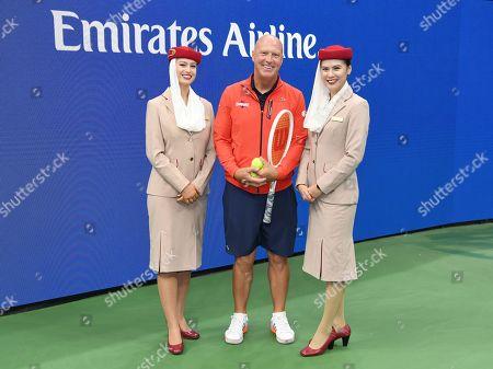 Luke Jensen with Emirates Airline Cabin Crew members