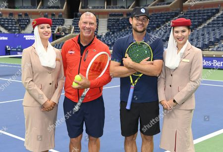 Stock Image of Luke Jensen and Andy Roddick with Emirates Airline Cabin Crew members