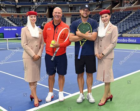 Stock Picture of Luke Jensen and Andy Roddick with Emirates Airline Cabin Crew members