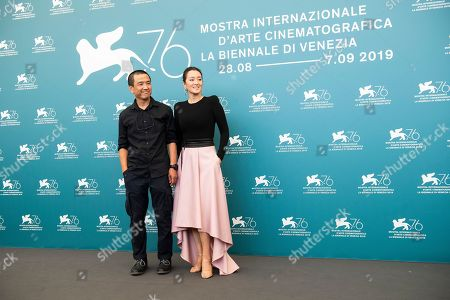 Lou Ye, Gong Li. Director Lou Ye, left, and actress Gong Li pose for photographers at the photo call for the film 'Saturday Fiction' at the 76th edition of the Venice Film Festival in Venice, Italy