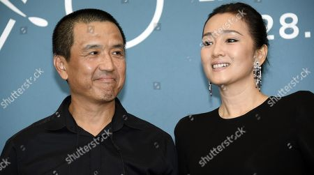 Gong Li (R) and Gong Li and Chinese director Lou Ye poses at a photocall for 'Lan Xin Da Ju Yuan (Saturday Fiction) ' during the 76th annual Venice International Film Festival, in Venice, Italy, 04 September 2019. The movie is presented in the official competition 'Venezia 76' at the festival running from 28 August to 07 September.