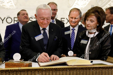 Stock Picture of Jerry Jones, Gene Jones. Dallas Cowboys owner, and major stockholder of Comstock Resources Jerry Jones, with wife Gene, signs the guest book before ringing the New York Stock Exchange opening bell, . The company is celebrating its $2.2 billion acquisition of Covey Park Energy. At center is Chairman & CEO of Comstock Resources Jay Allison