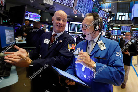John O'Hara, Steven Kaplan. Specialist John O'Hara, left, and trader Steven Kaplan work on the floor of the New York Stock Exchange, . Stocks are opening higher on Wall Street following big gains in Asia as Hong Kong's government withdrew a controversial extradition law that set off three months of protests there