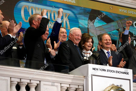 Stock Image of Jerry Jones, Gene Jones. Dallas Cowboys owner, and major stockholder of Comstock Resources Jerry Jones, with wife Gene, is applauded as he rings the New York Stock Exchange opening bell, . The company is celebrating its $2.2 billion acquisition of Covey Park Energy