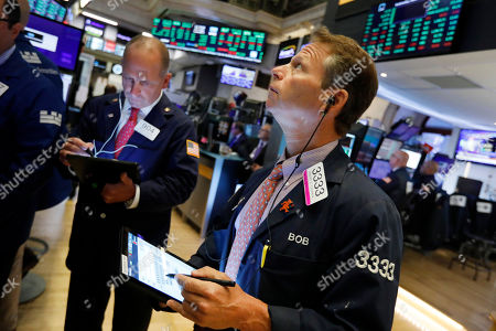 Michael Urkonis, Robert Charmak. Traders Michael Urkonis, left, and Robert Charmak work on the floor of the New York Stock Exchange, . Stocks are opening higher on Wall Street following big gains in Asia as Hong Kong's government withdrew a controversial extradition law that set off three months of protests there