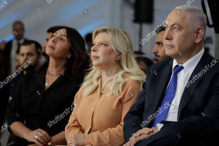 Benjamin Netanyahu, Sara Netanyahu, Miri Regev. Israeli Prime Minister Benjamin Netanyahu, right, Sara Netanyahu, center, and Israeli Sports and Culture Minister Miri Regev, sit during a ceremony near Hebron's holiest site, known to Jews as the Tomb of the Patriarchs and to Muslims as the Ibrahimi Mosque in the Israeli controlled part of the West Bank city of Hebron, . Israel's prime minister is visiting the volatile West Bank city of Hebron under tight security in a move widely perceived as a bid to garner support from ultra-nationalists ahead of next month's elections