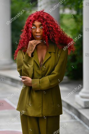 """This photo shows music artist Buku Abi, born Joann Kelly, posing in Atlanta. As the daughter of R. Kelly, she experienced her fair share of hardships. She is no longer in touch with him and says being R. Kelly's daughter is like """"a double-edged sword."""" In March, Abi released her debut EP """"Don't Call Me"""" and she appeared on the WEtv reality series, """"Growing Up Hip Hop: Atlanta"""