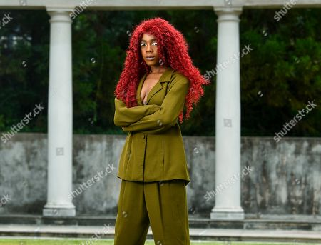 "Stock Image of This photo shows music artist Buku Abi, born Joann Kelly, posing in Atlanta. As the daughter of R. Kelly, she experienced her fair share of hardships. She is no longer in touch with him and says being R. Kelly's daughter is like ""a double-edged sword."" In March, Abi released her debut EP ""Don't Call Me"" and she appeared on the WEtv reality series, ""Growing Up Hip Hop: Atlanta"
