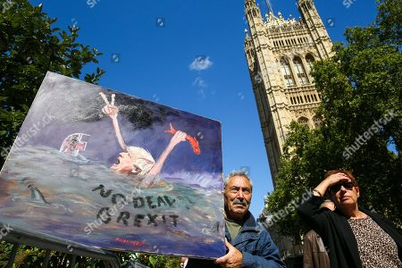 Artist Kaya Mar with his latest piece of satirical artwork showing the British Prime Minister Boris Johnson drowning in the sea outside Victoria Tower in Westminster.