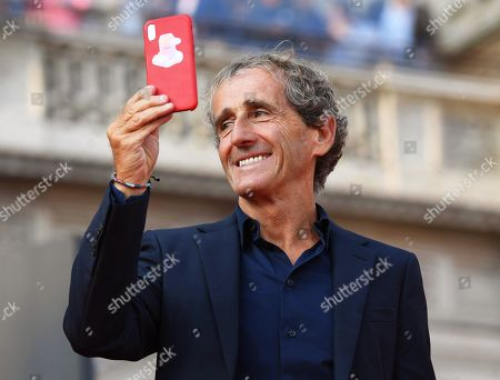 Former French Formula One driver Alain Prost attends an event to celebrate the 90th anniversary of the foundation of Italian sports car manufacturer Ferrari at the Duomo square in Milan, Italy, 04 September 2019. The Ferrari company was founded by Enzo Ferrari in 1939 in Modena, Italy, under the name of Auto Avio Costruzioni.