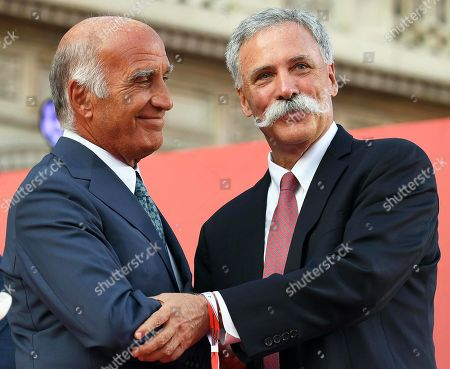 Formula One Group CEO Chase Carey (R) and the president of the Automobile Club d'Italia (ACI), Angelo Sticchi Damiani (L) shake hands after signing a contract extension of the Formula One Grand Prix in Monza for five years during an event to celebrate the 90th anniversary of the foundation of Italian sports car manufacturer Ferrari at the Duomo square in Milan, Italy, 04 September 2019. The Ferrari company was founded by Enzo Ferrari in 1939 in Modena, Italy, under the name of Auto Avio Costruzioni.