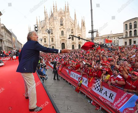 Former Ferrari chairman Luca Cordero di Montezemolo throws hats into the crowd during an event to celebrate the 90th anniversary of the foundation of Italian sports car manufacturer Ferrari at the Duomo square in Milan, Italy, 04 September 2019. The Ferrari company was founded by Enzo Ferrari in 1939 in Modena, Italy, under the name of Auto Avio Costruzioni.