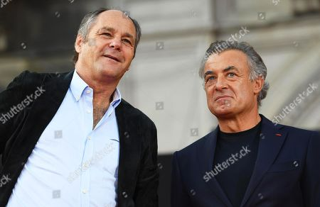 Former Formula One drivers Gerhard Berger (L) of Austria and Jean Alesi (R) of France attend an event to celebrate the 90th anniversary of the foundation of Italian sports car manufacturer Ferrari at the Duomo square in Milan, Italy, 04 September 2019. The Ferrari company was founded by Enzo Ferrari in 1939 in Modena, Italy, under the name of Auto Avio Costruzioni.