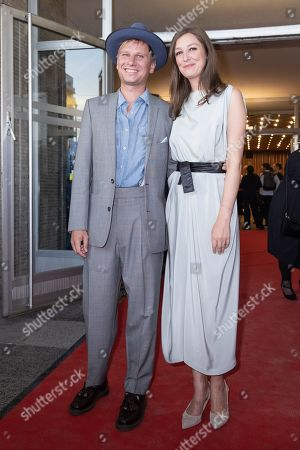 Stock Photo of Robert Stadlober (L) and German-Romanian actress/cast member Alexandra Maria Lara (R) pose during a premiere of 'Und der Zukunft zugewandt' (Sealed Lips) at the Kino International in Berlin, Germany, 04 September 2019. The movie is scheduled to open to in German theaters on 05 September.