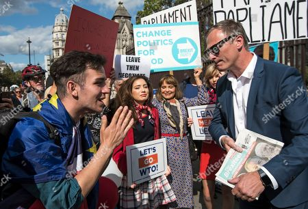 Brexit Party MEP Martin Daubney has a heated discussion with a pro EU supporters outside the Houses of Parliament in Westminster