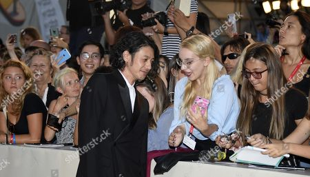 Joe Odagiri signs autographs as he arrives for the premiere of 'Lan Xin Da Ju Yuan (Saturday Fiction)' during the 76th annual Venice International Film Festival, in Venice, Italy, 04 September 2019. The movie is presented in the official competition 'Venezia 76' at the festival running from 28 August to 07 September.ORATI