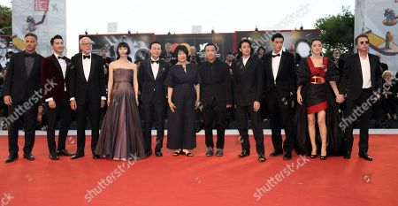 Cast and crew , Tom Wlaschiha, Mark Chao, Pascal Greggory, Huang Xiangli, Songwen Zhang, Ma Yingli, director Lou Ye, Joe Odagiri, Ayumu Nakajima, Gong Li and Jean Michel Jarre arrive for the premiere of 'Lan Xin Da Ju Yuan (Saturday Fiction)' during the 76th annual Venice International Film Festival, in Venice, Italy, 04 September 2019. The movie is presented in the official competition 'Venezia 76' at the festival running from 28 August to 07 September.