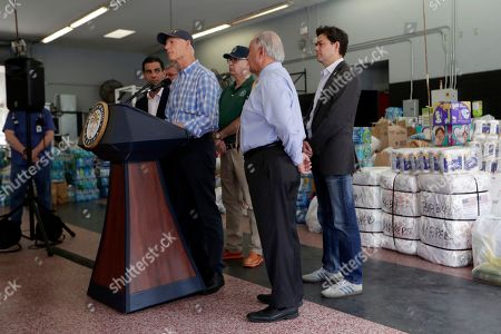 Sen. Rick Scott, R-Fla., left, gives a briefing to the news media as city officials look on at a fire station in Miami where relief supplies are being donated for those affected by Hurricane Dorian in the devastated Bahamian islands of Abaco and Grand Bahama, . Local churches are also accepting supplies in a relief effort spearheaded by descendants of some of Miami's earliest settlers from the Bahamas